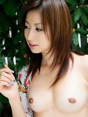 Cute gravure idol chick showing off her plump tits and panties